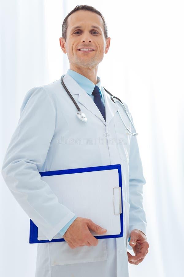 Услаженный доктор ждать его пациентов стоковые изображения