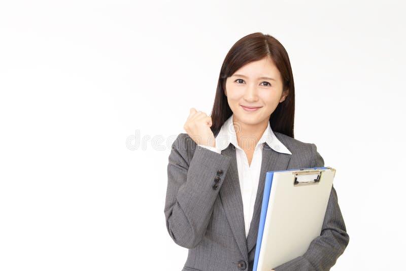Усмехаться дамы офиса стоковое фото