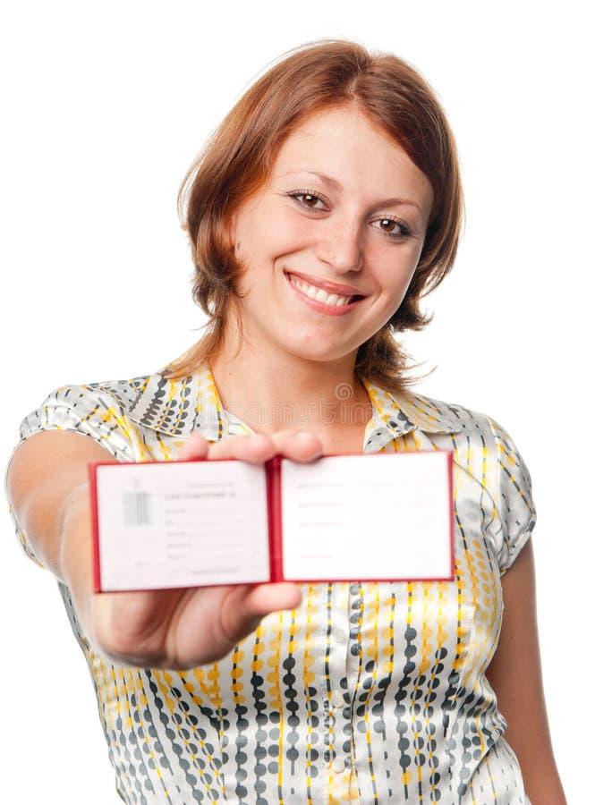 усмехаться владений девушки сертификата стоковая фотография rf