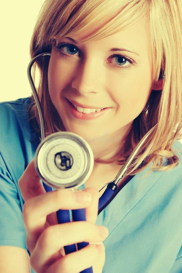 Усмехаться медсестры стетоскопа стоковое изображение rf