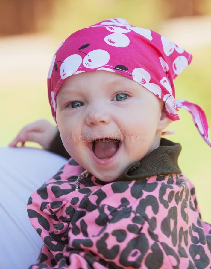 усмехаться младенца Радостное выражение стоковое фото