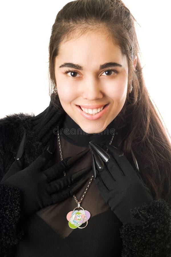 усмехаться портрета перчаток девушки стоковое фото rf