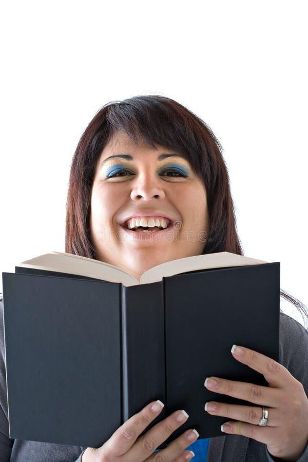 усмехаться читателя книги счастливый стоковая фотография