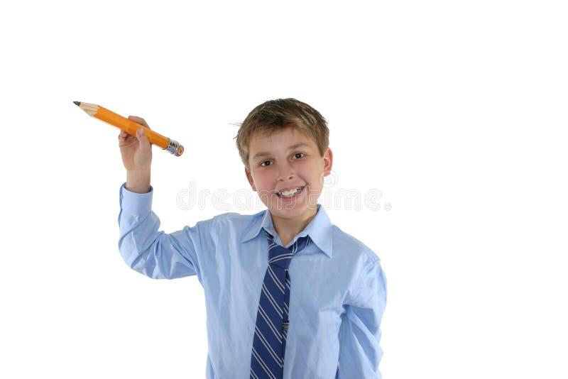 усмехаться школьника карандаша удерживания стоковые изображения rf