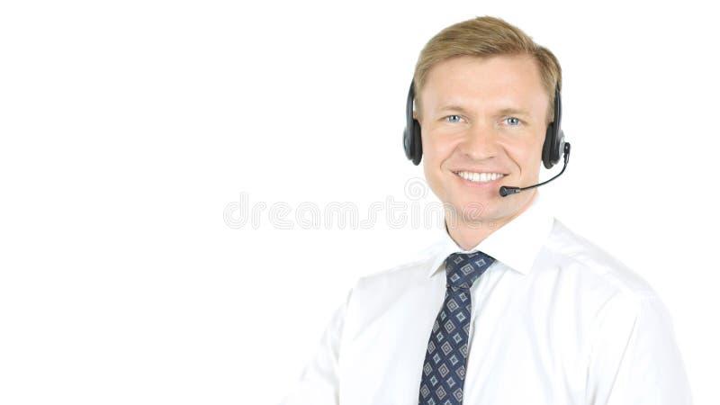 Усмехаясь агент, оператор вспомогательного обслуживания работы с клиентом стоковое фото rf