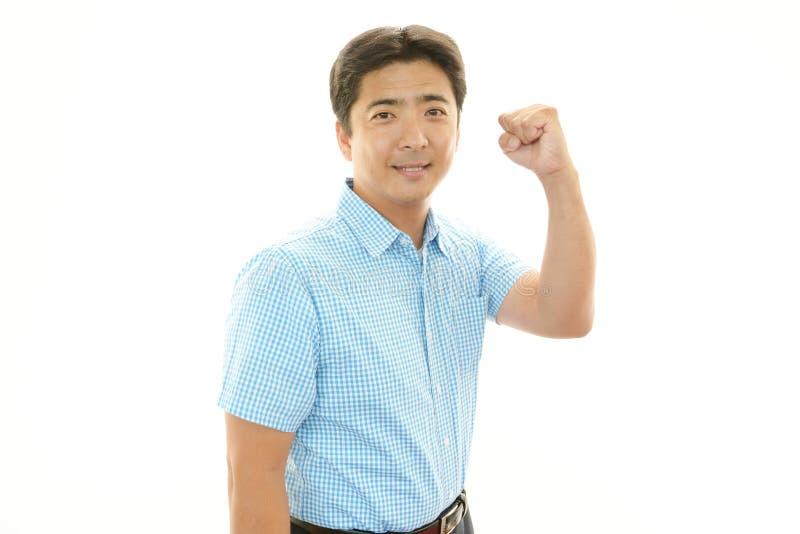 Усмехаясь азиатский человек стоковое изображение rf