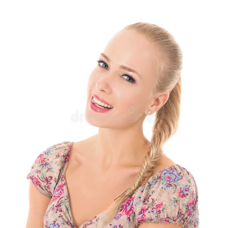 Усмехаясь блондинка стоковые фото