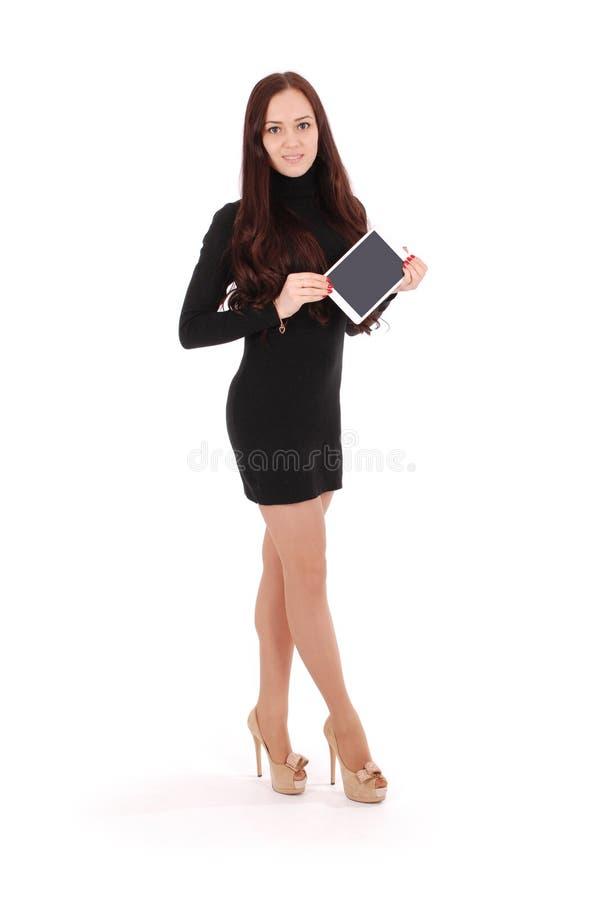 Усмехаясь девочка-подросток студента с ПК таблетки стоковое изображение