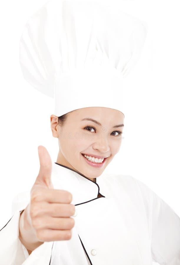 Усмехаясь женские шеф-повар, кашевар или хлебопек показывая большие пальцы руки вверх стоковые фотографии rf