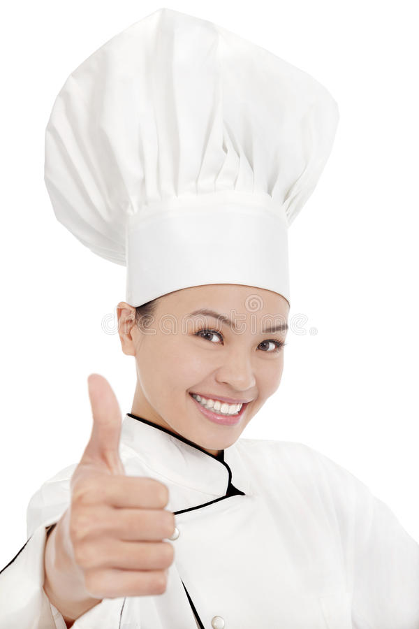 Усмехаясь женские шеф-повар, кашевар или хлебопек показывая большие пальцы руки вверх стоковые изображения rf