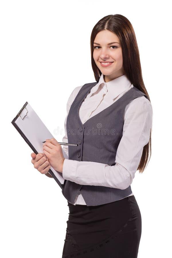 Усмехаясь женщина, женский бухгалтер или менеджер HR при изолированная доска сзажимом для бумаги стоковая фотография rf