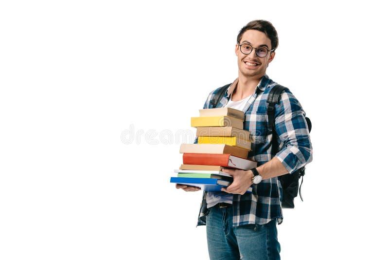 усмехаясь красивый стог удерживания студента книг стоковое фото