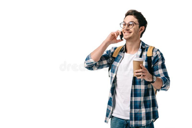 усмехаясь красивый студент говоря smartphone стоковое фото rf
