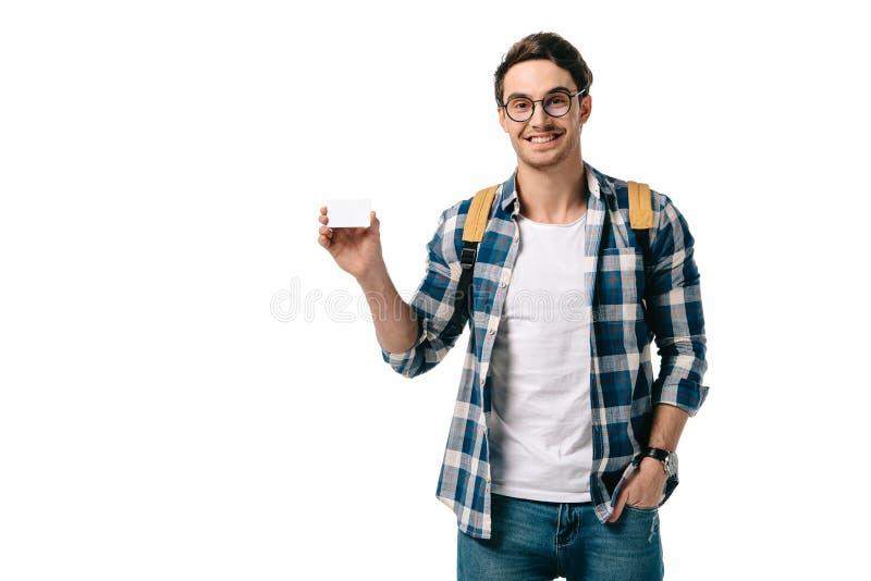усмехаясь красивый студент показывая кредитную карточку стоковые изображения rf