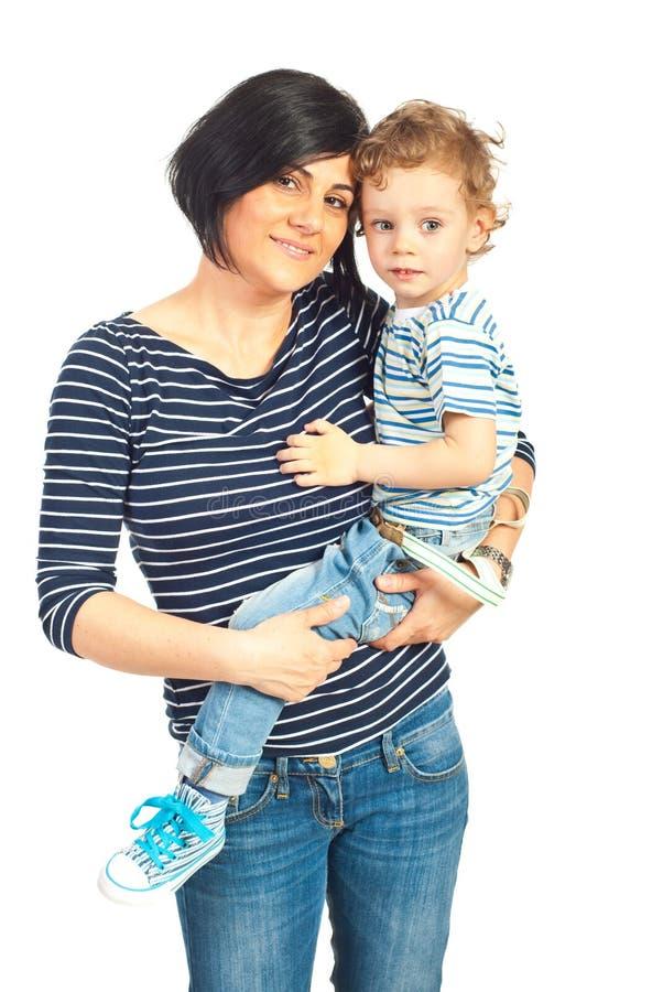 Усмехаясь мать и ее сын стоковая фотография rf