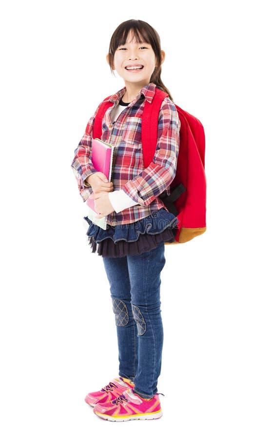 усмехаясь маленькая девочка держа книги стоковая фотография