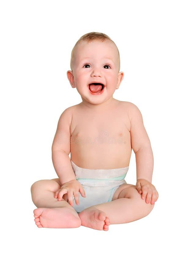 Усмехаясь мальчик в пеленке на белой изолированной предпосылке стоковое изображение rf