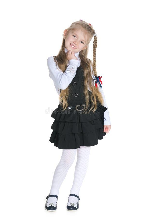 Усмехаясь милая маленькая девочка на белизне стоковые изображения rf