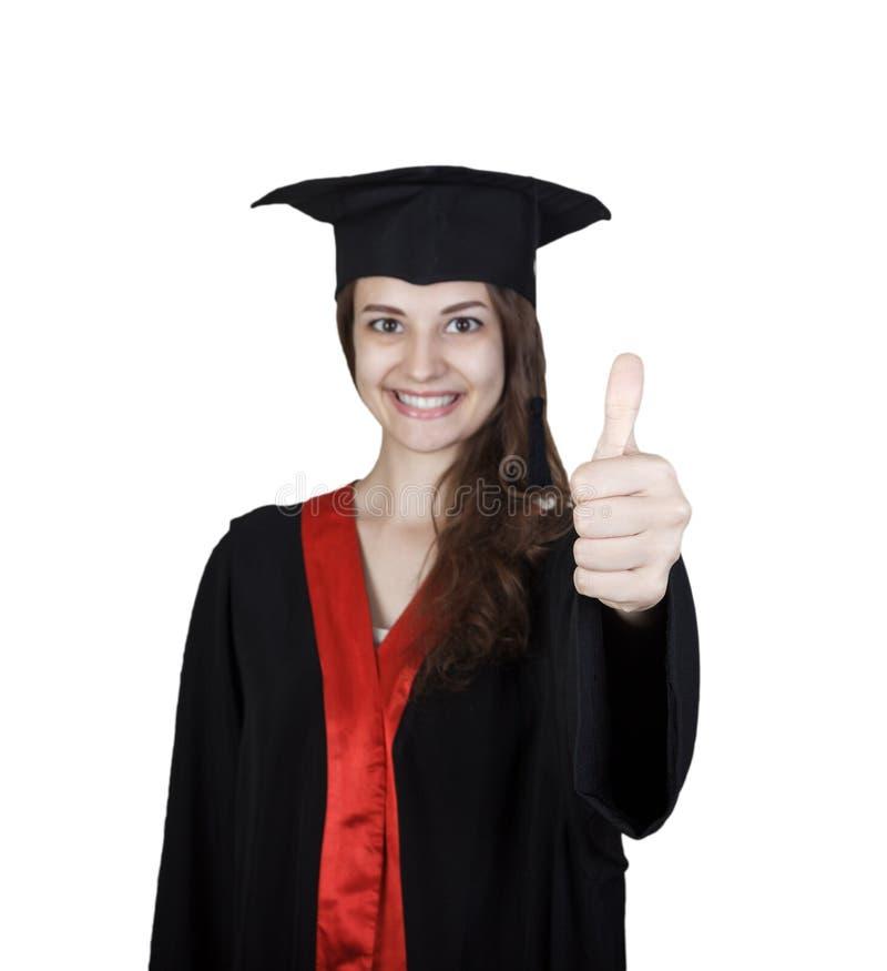 Усмехаясь молодая женщина в градации одевает показывать большие пальцы руки вверх стоковое изображение