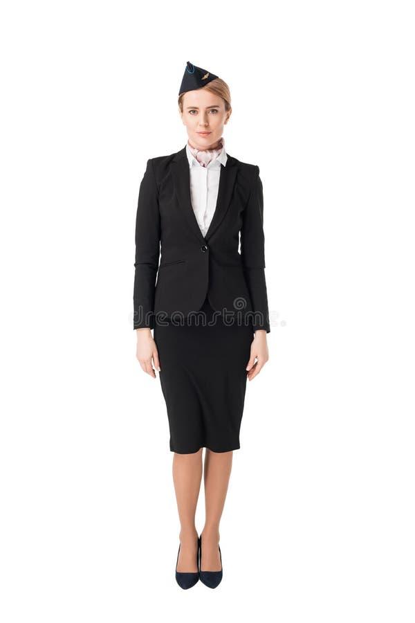 Усмехаясь молодой stewardess в костюме стоковое фото rf