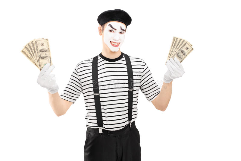 Усмехаясь мужской художник пантомимы держа доллары США и смотреть camer стоковое фото