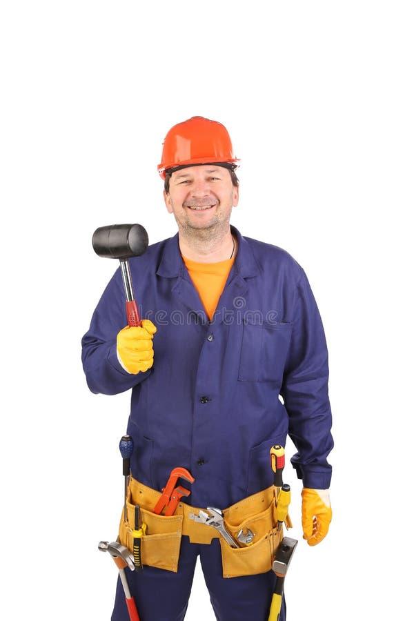 Усмехаясь работник с инструментами стоковое фото