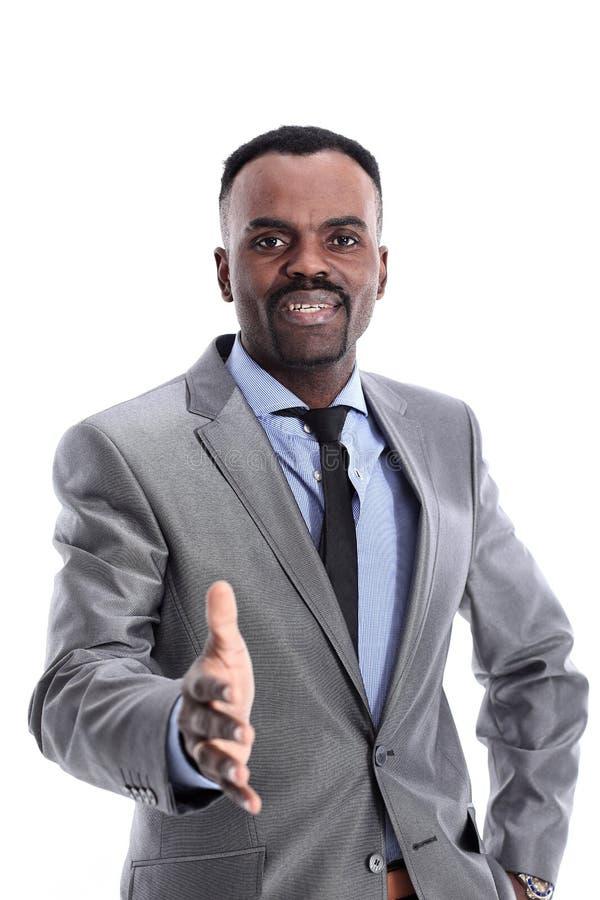 Усмехаясь успешный Афро-американский бизнесмен давая руку стоковое изображение rf