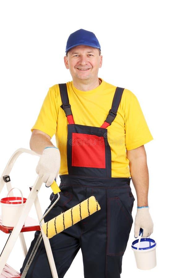 Усмехаясь человек в прозодежде. стоковое изображение
