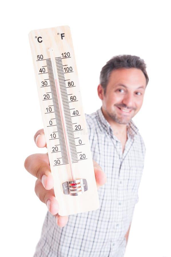Усмехаясь человек держа термометр стоковое изображение rf