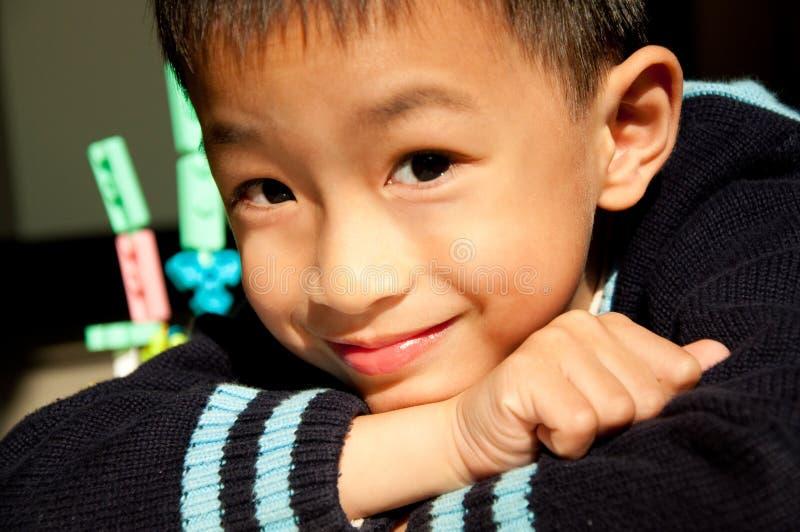 усмешка мальчика стоковое фото rf