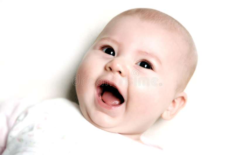 усмешка ребенка S Стоковые Фото