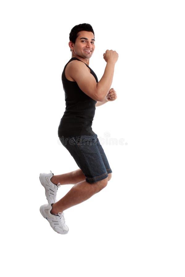 успех человека кулачка скача стоковые изображения rf