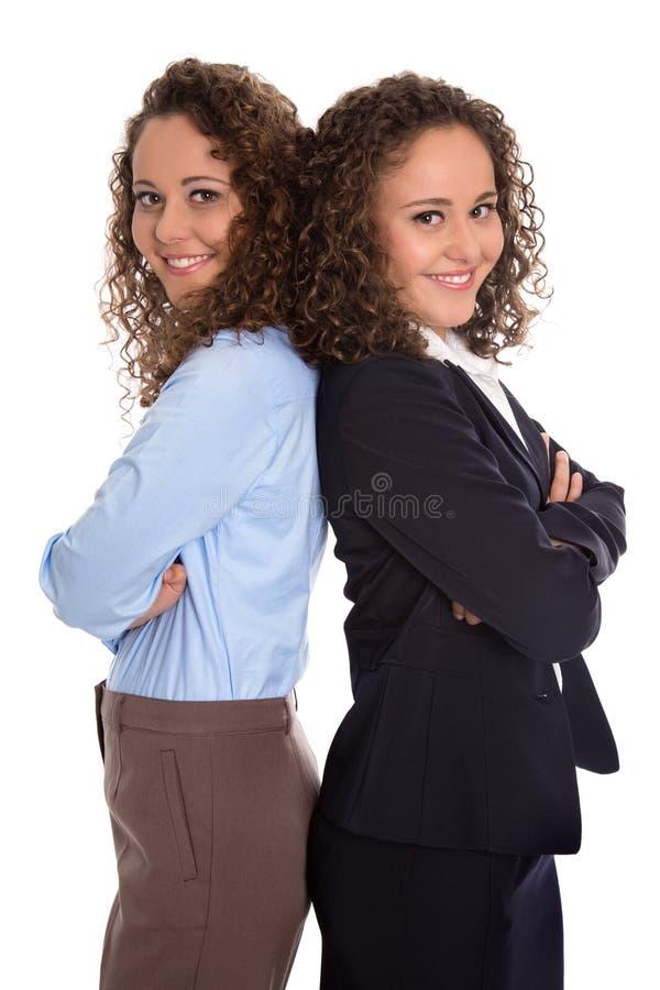 Успешная изолированная молодая бизнес-леди - реальные близнецы работая к стоковое фото rf