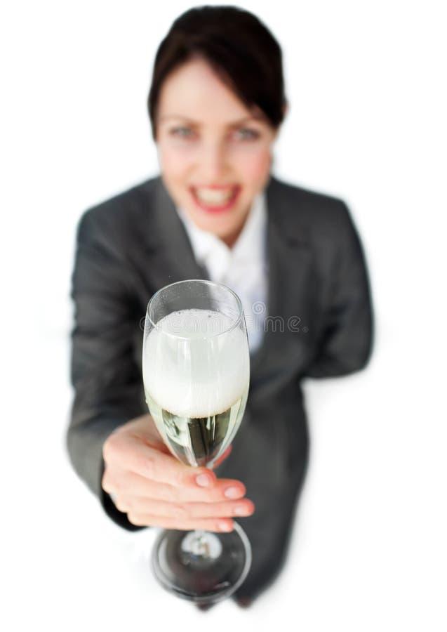 Успешная коммерсантка toasting с Шампань стоковая фотография
