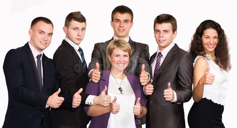 Успешные бизнесмены с большими пальцами руки поднимают и стоковые изображения