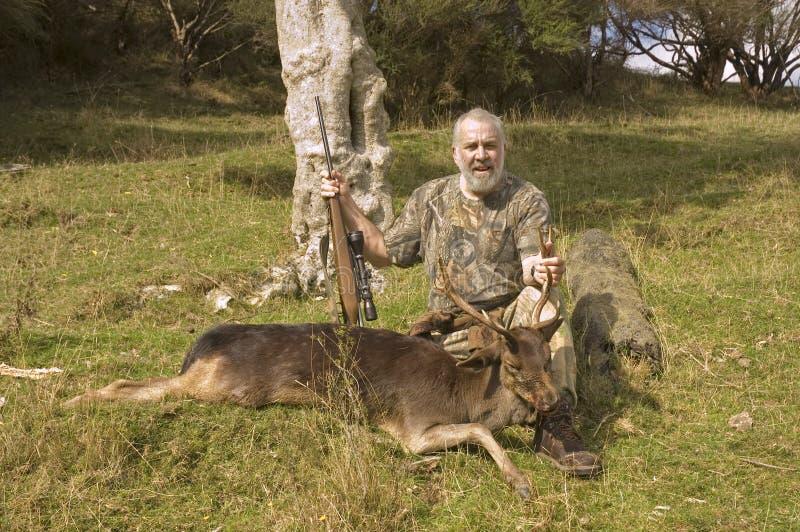 Успешные охотник и приз стоковая фотография