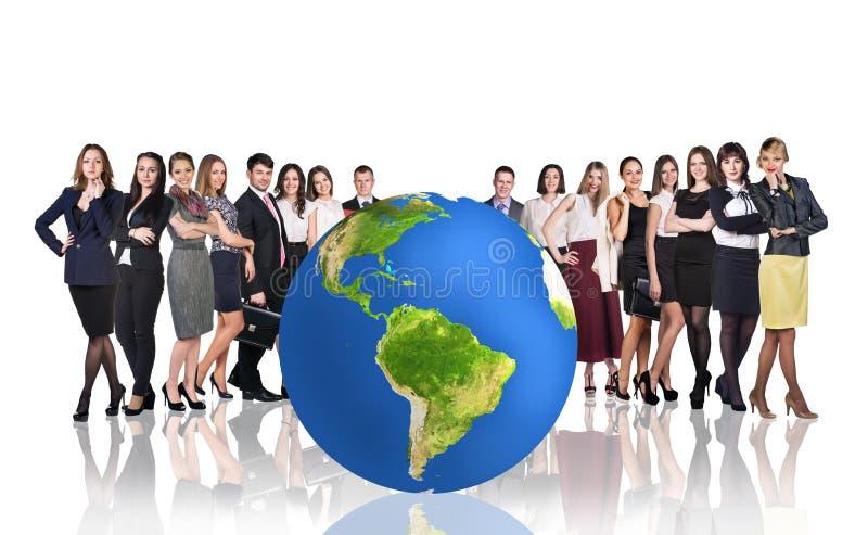 Успешные предприниматели около большого шарика земли стоковая фотография rf