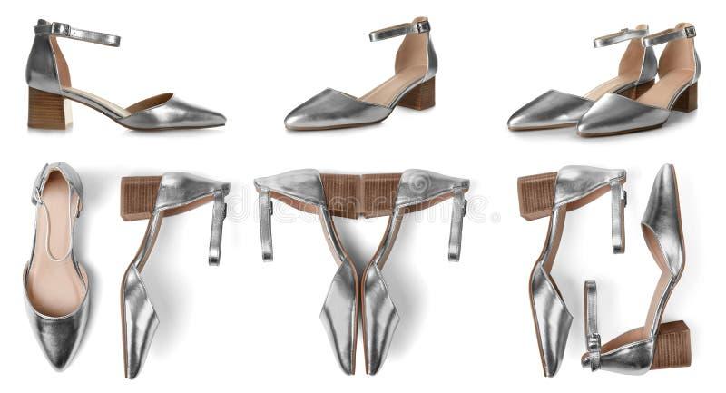 Установите стильных серебряных женских ботинок на белизне стоковое фото rf