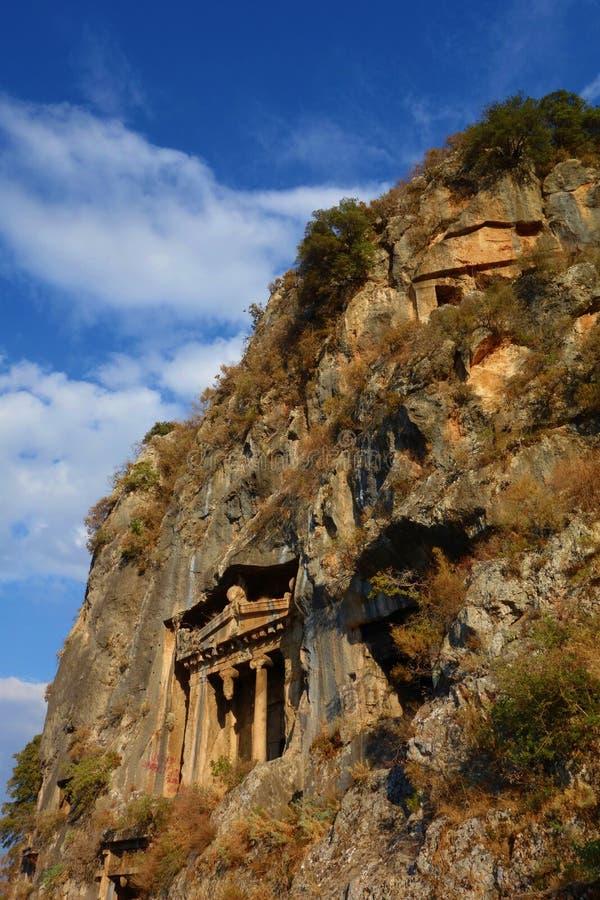 Усыпальница Amyntas, старые усыпальницы утеса Lycian в Fethiye, Турции стоковое фото rf