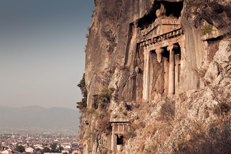 Усыпальницы утеса в Fethiye, Турции стоковые фото