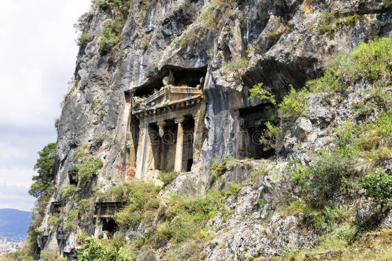 Усыпальницы утеса Amynthas древнего города Telmessos в Fethiye, Турции стоковое фото rf