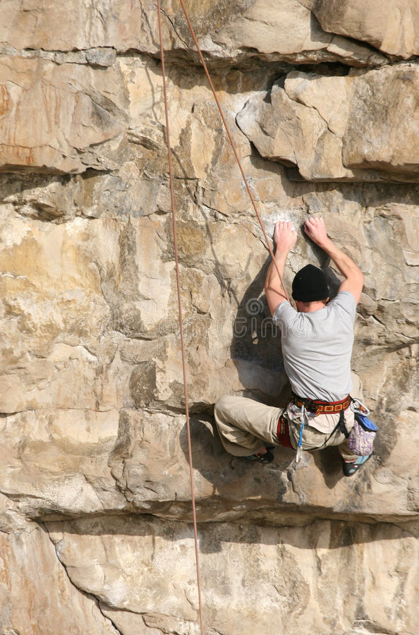 утес альпиниста стоковое фото