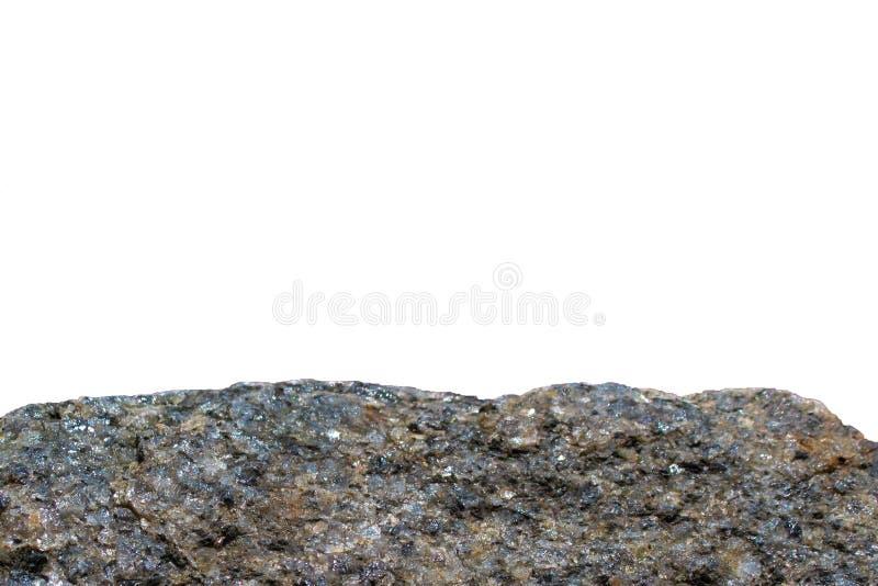 Утес или камень на белой предпосылке r Closeu геологии минеральной изолированное текстурой стоковое фото