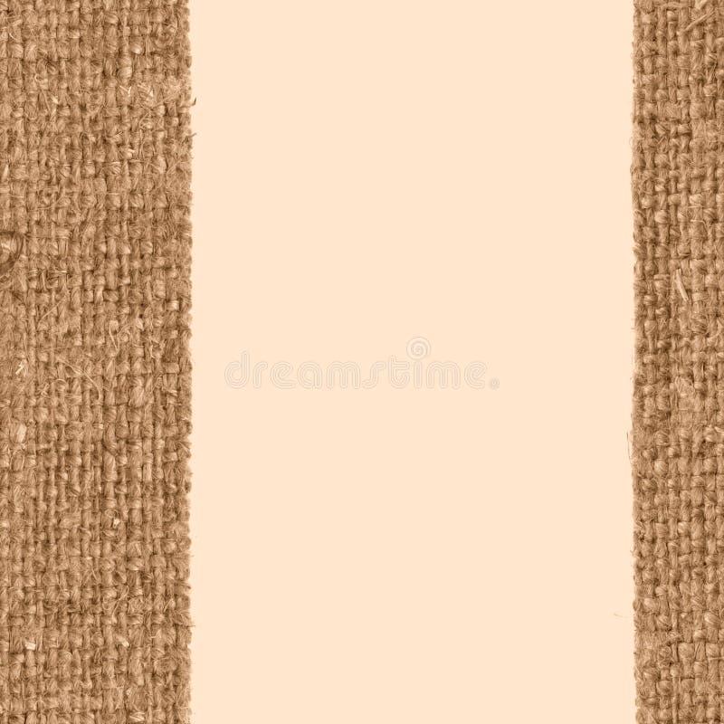 Уток ткани, заплата ткани, желтый холст, устарелый материал, предпосылка конца-вверх стоковое фото