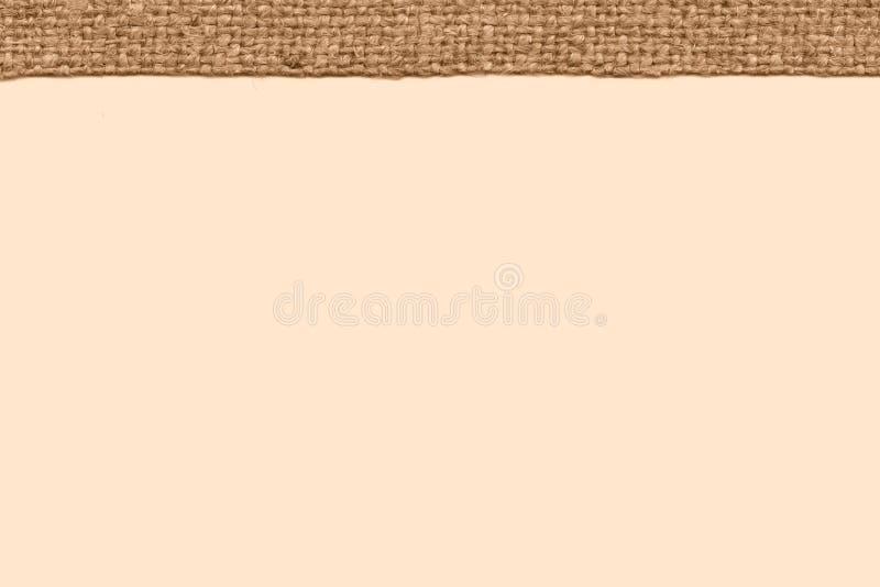 Уток ткани, интерьер ткани, холст верблюда, запятнал материал, предпосылку простоты стоковое фото rf