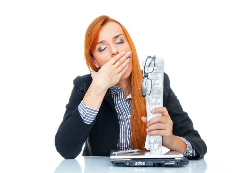 Утомленный зевок женщины дела стоковое фото