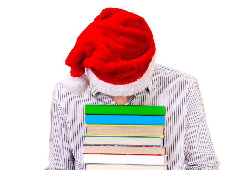 Утомленный молодой человек в шляпе Санты стоковое изображение rf
