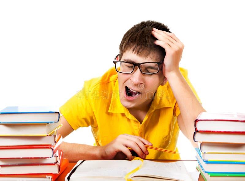 Утомленный студент зевая стоковое фото rf