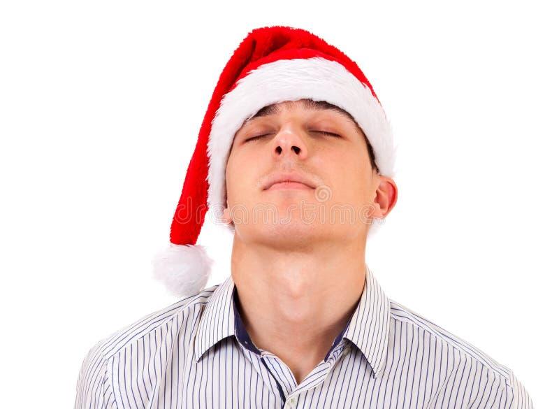 Утомленный человек в шляпе Санты стоковые фото