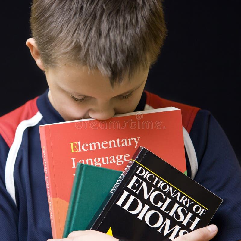 утомлянный учить английской языка стоковые фото